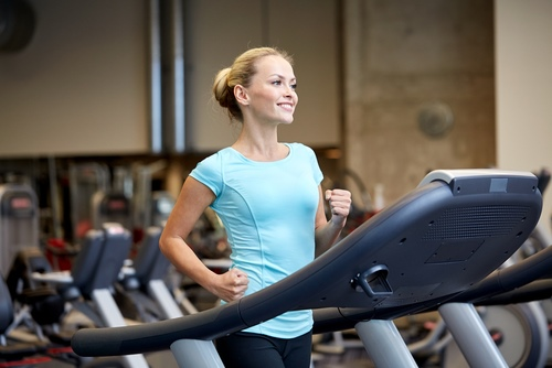 Woman jogging in a gym
