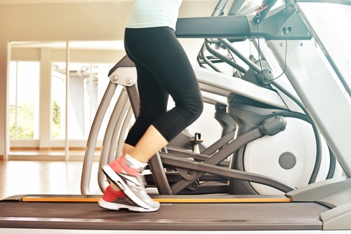 Female walking on a treadmill