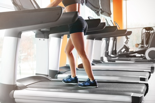 Walking on a treadmill in a gym